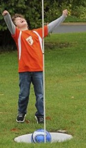 Wil Paper, 7, celebrates a great kick during a round of foot golf at the Mendota Heights Par 3 Golf Course, on Wednesday, October 1, 2014. (Pioneer Press: Scott Takushi)